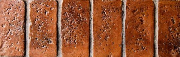 worn brick concrete border example