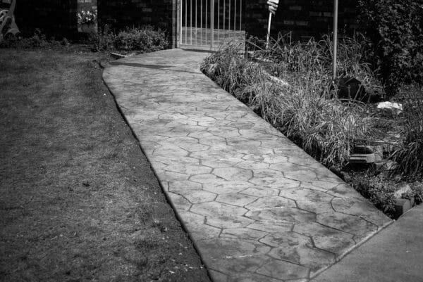 bc-random-stone-stamped-concrete-path-walttools-black-and-white