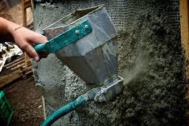 mortar sprayer applying structure coat