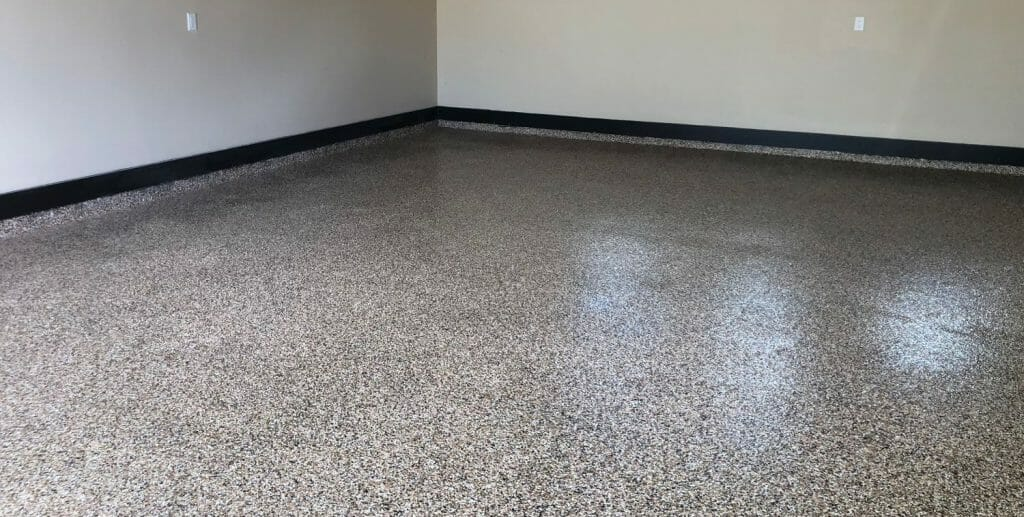 Example of a partial broadcast epoxy garage floor system