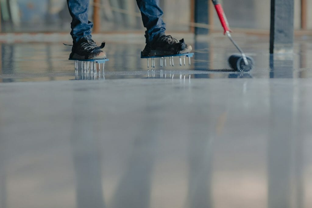 Use spikes when creating an epoxy floor system
